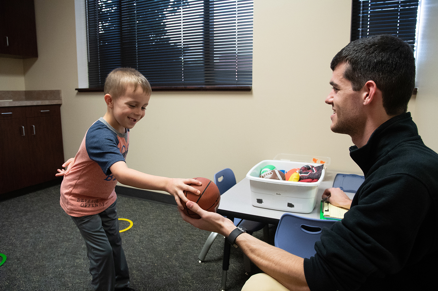 This is a photo of a student speech therapist working with a client.