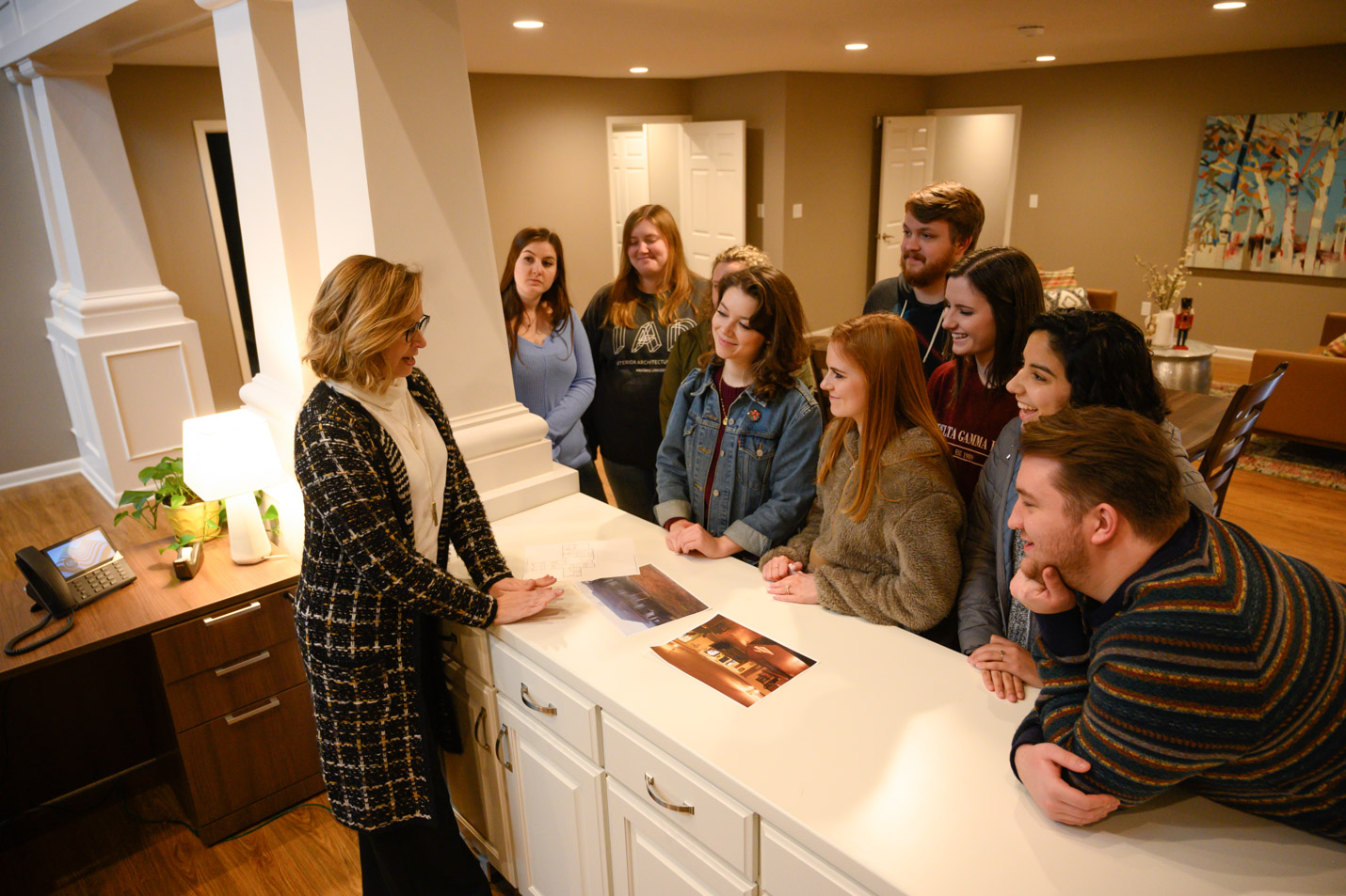 This is a photo of Assistant Professor of Art Amy Cox and several interior architecture and design students in the newly renovated Sparrow's Promise.