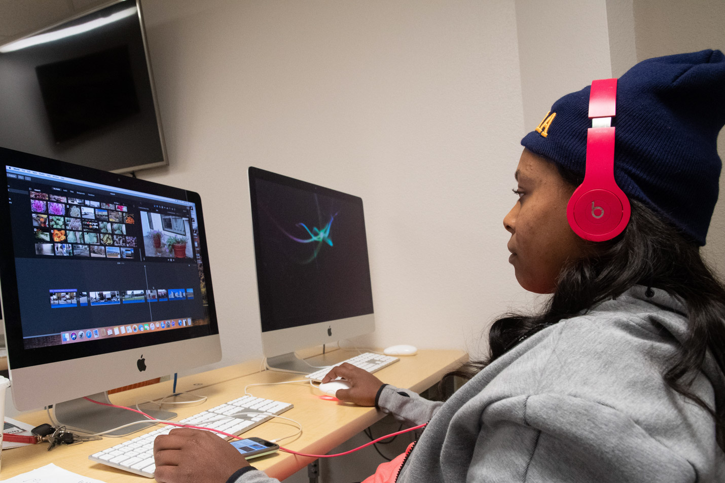 This is a photo of a student in the communication department at Harding University working on a video project.