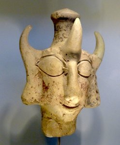 Stone statue that is a head with three horns