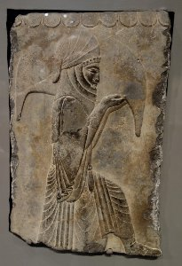 Tablet with image of attendant kneeling holding wineskin