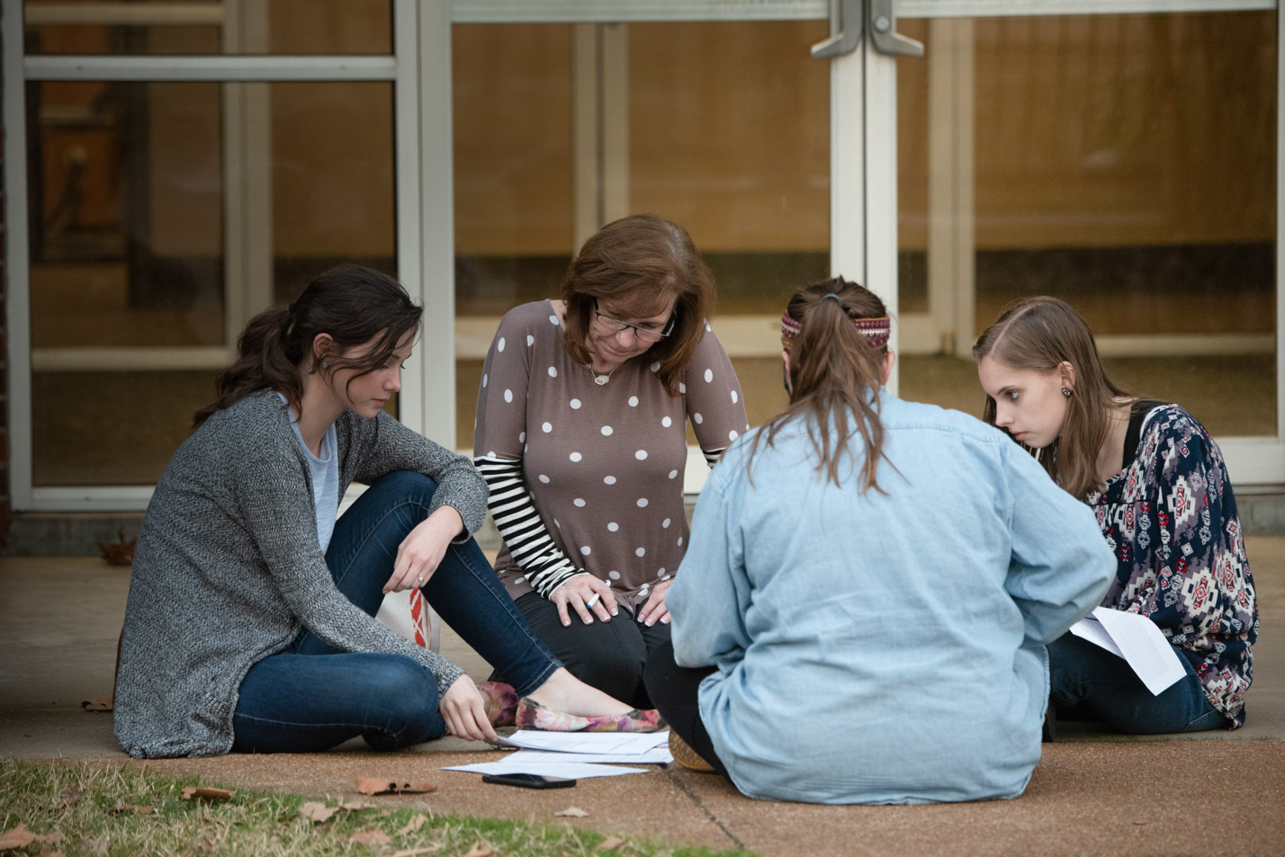 This is a photo of students working with an education professor.