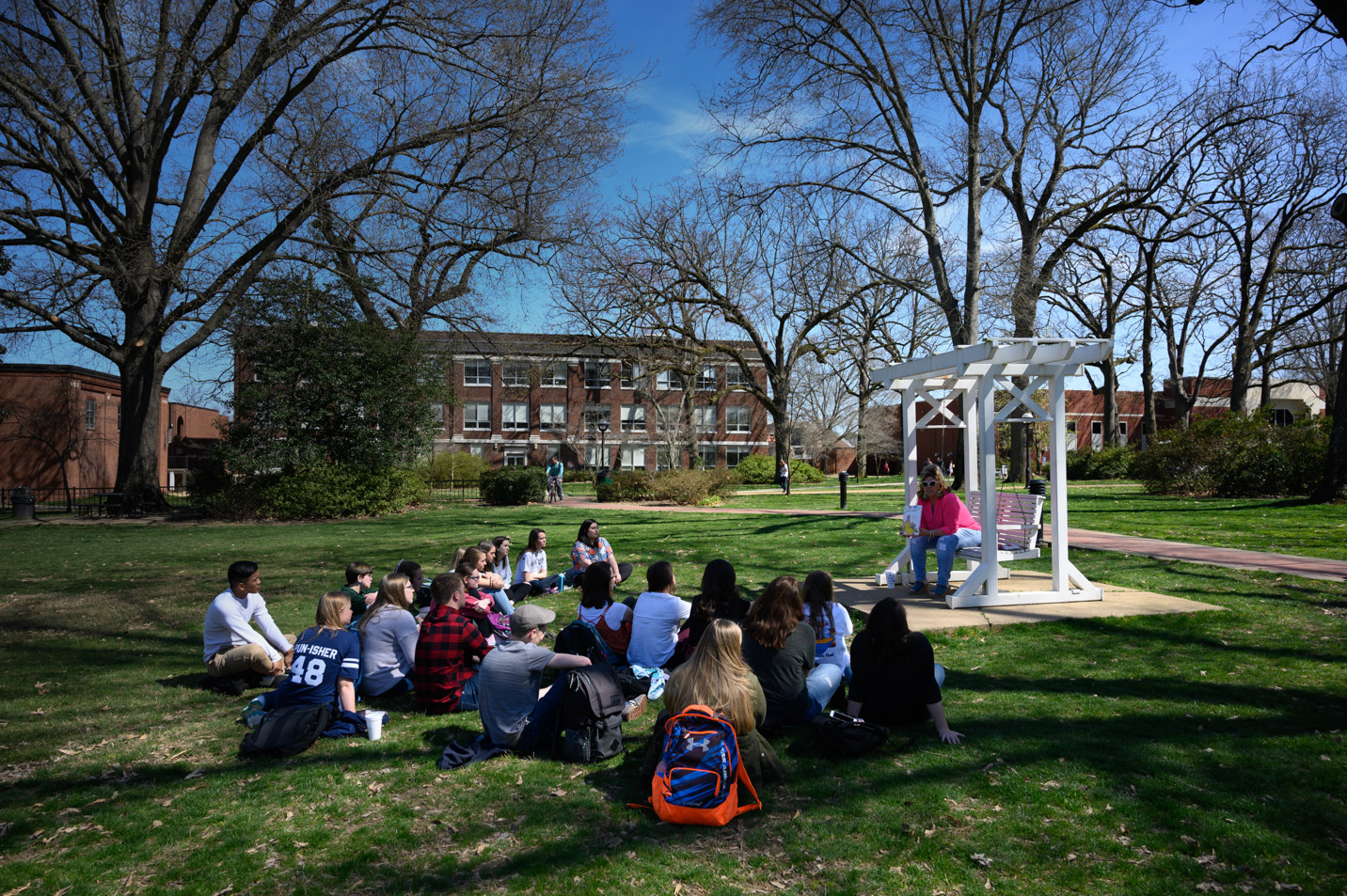 This is a photo of students meeting for class outside.