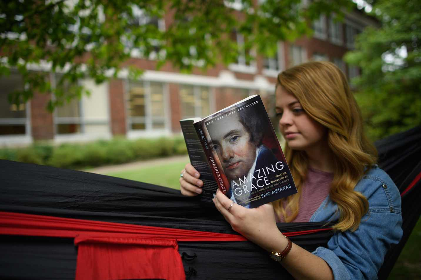 This is a photo of a student reading the bookAmazing Grace.