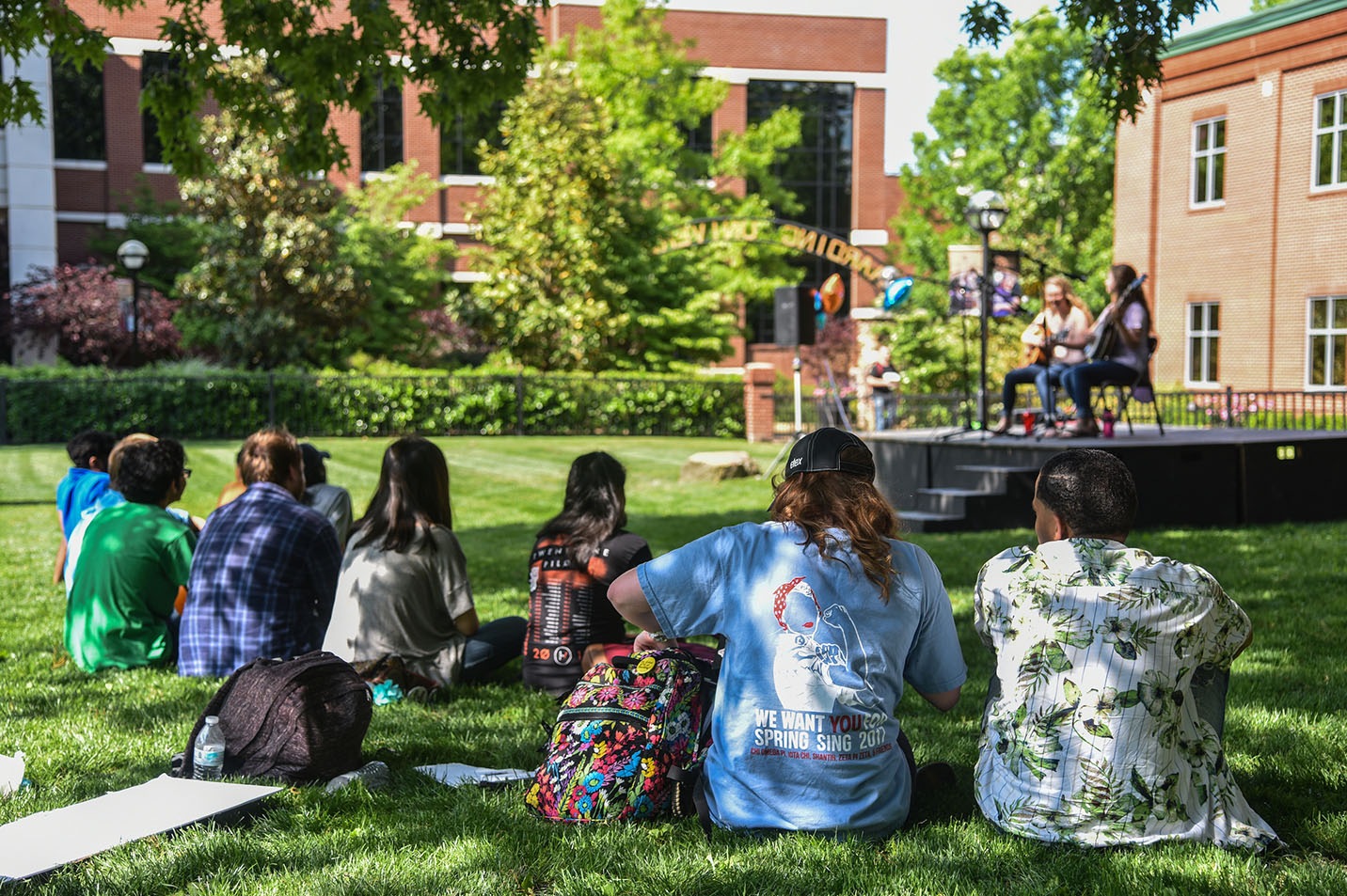 This is a photo of students sitting at a concert on the Front Lawn.